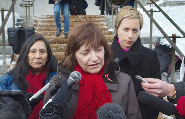>Sheryl Kiselbach (left, with lawyer Katrina Pacey) speaks on the front steps of the Supreme Court of Canada building in Ottawa Thursday.