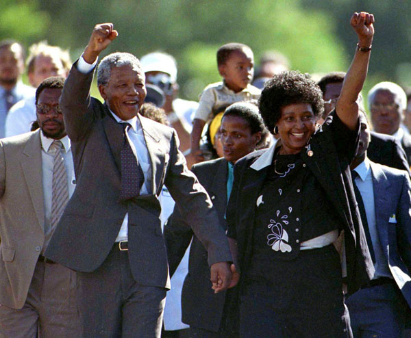 File photo of Nelson Mandela, accompanied by his wife Winnie, walking out of the Victor Verster prison, near Cape Town