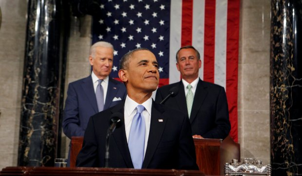 U.S. President Barack Obama smiles as he arrives to deliver his State of the Union speech on Capitol Hill in Washington January 28, 2014.   REUTERS/Larry Downing (UNITED STATES  – Tags: POLITICS)