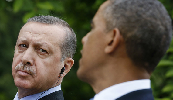 Turkish Prime Minister Erdogan listens as U.S. President Obama addresses a joint news conference at the White House in Washington