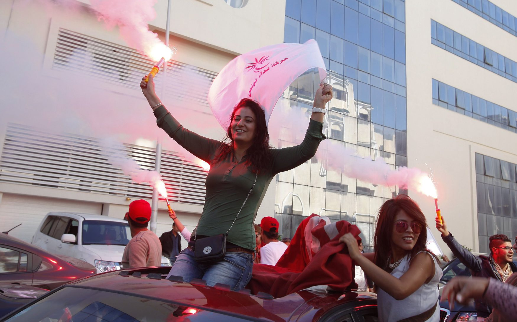 Supporters  of the Nida Tounes (Call of Tunisia) secular party movement wave flags and shout slogans outside Nidaa Tounes headquarters in Tunis
