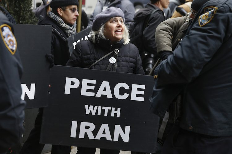 A demonstrator holds a sign during a rally near the Israeli Consulate in New York